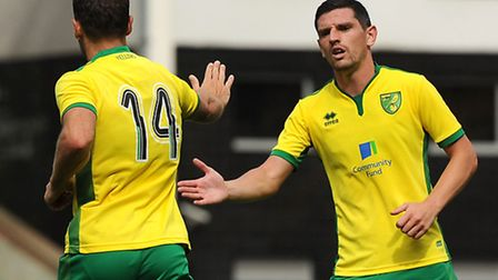 Wes Hoolahan of Norwich City celebrates scoring his side's second goal to make the scoreline 2-3 wit