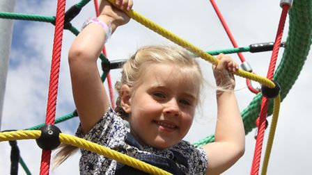 Six-year-old Maddie Fish tries out the new 'rocket launch' climbing frame at Sheringham's Cromer Roa