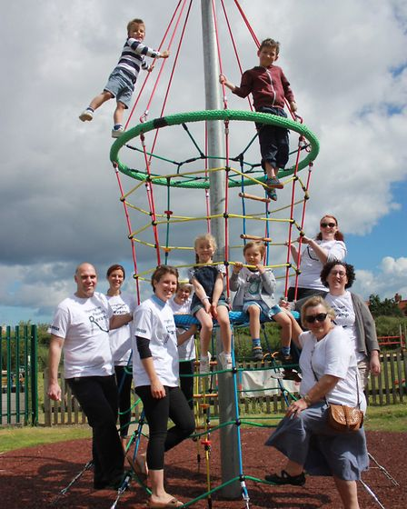Sheringham Playpark Revamp Appeal's new committee and youngsters with the 'rocket launch' climbing f