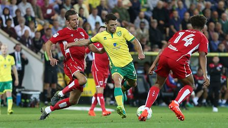 Wes Hoolahan and former Norwich City team mate Gary O'Neil in action during the Canaries' 1-0 Champi