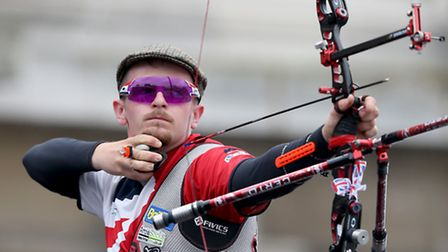Great Britain's Patrick Huston in action during the Men's Recurve Team Gold Medal Final during the E