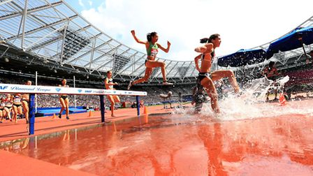 USA's Stephanie Garcia and Jamaica's Aisha Praught (centre) clear the water jump during the women's