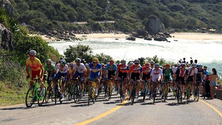 The Peloton in action during the Men's Road race which takes place on the Copacabana on the first da