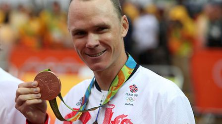 Great Britain's Chris Froome with his bronze medal from the men's road cyling individual time trials