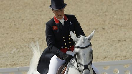 Pippa Funnell, of Britain, rides Billy The Biz in the equestrian eventing dressage competition at th