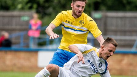 Dan Quigley, back, shone in the sunshine for the Linnets. Picture: MATTHEW USHER