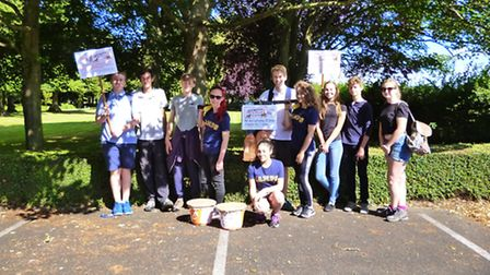 Four teenagers and their friends walked from Hethersett to Norwich to raise money for their trip to