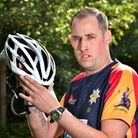 Brian Medler pictured with the £20 cycle helmet which he says saved his life.Picture: ANTONY KELLY