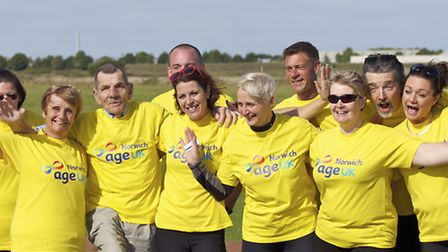 Philip Goldsmith (third from left) celebrates his dive with the Age UK team