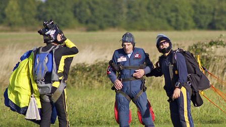 Philip Goldsmith (middle) becomes the oldest person to sky dive at Beccles Airfield