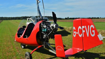 A buckled propellor hampered efforts to remove the red autogyro from the airfield. Picture: DAVE HUB