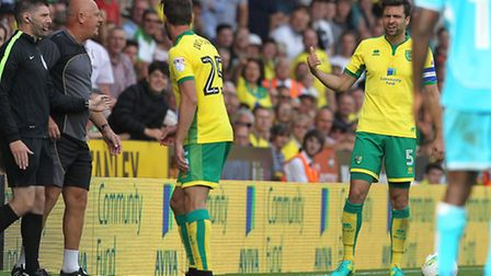 Norwich City captain Russell Martin was embroiled in a touchline spat with Burton Albion coach Andy