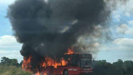 A bus on fire in a lay by near Acle. Photo: Charlotte Thompson