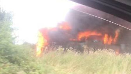 A bus on fire in a lay by near Acle. Photo: Jake Nolloth