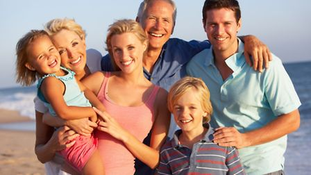 Generic photo of a three generations of a family at the beach. Photo: Getty Images/iStockphoto