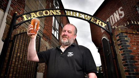 A day in the life of Lacons Brewery head brewer, Wil Wood. Wil pictured with a pint of one of their