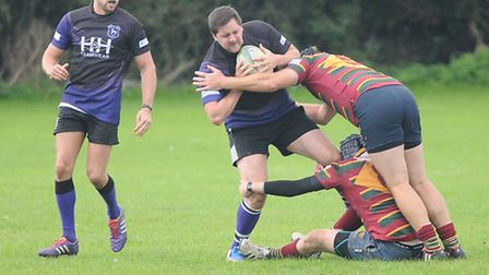 Action from (purple) Dereham Rugby Club's clash with Norwich. Picture: Ian Burt