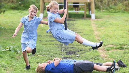 The official opening of the new play area at Sculthorpe playing field. On the zip wire is Megan Haws