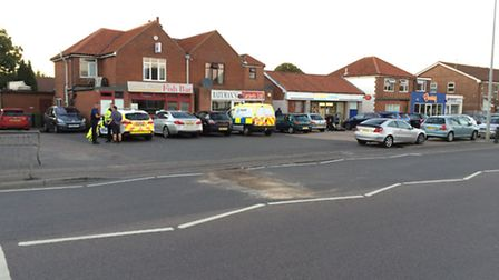 The scene of a crash between a car and a motorbike on Wroxham Road, Norwich.
