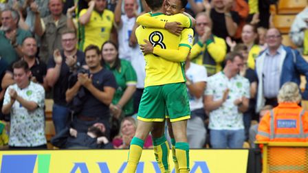 Josh Murphy, facing, celebrates his goal with Jonny Howson. Picture: PAUL CHESTERTON/FOCUS IMAGES