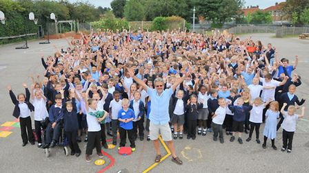 Headteacher Tim Lawes(front centre) and the pupils and staff of Catton Grove Primary celebrate their