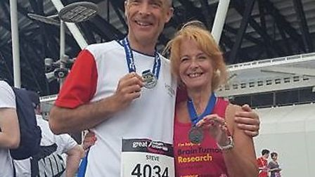 A widow whose husband died of a brain tumour is getting set to tackle her first half marathon in his