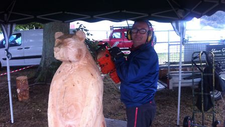 Chainsaw sculptor Shaun Gilbert. Picture: MILES JERMY