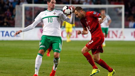 Northern Ireland's Kyle Lafferty (left) and Czech Republic's Michal Kadlec battle for the ball durin