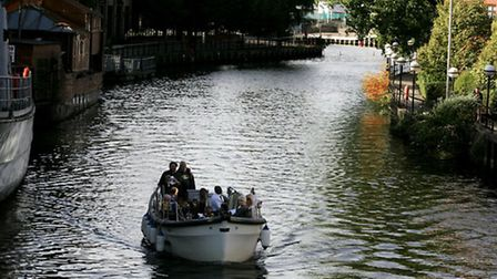 Christians welcome refugee flotilla on its way to dock at Pull's Ferry in Norwich