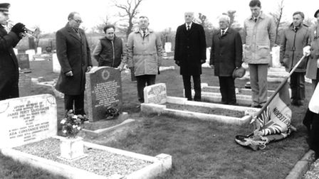 Members of Sprowston branch of the Royal British Legion gather around the gravestone of Captain Harr