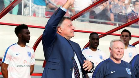 England manager Sam Allardyce waves to the travelling fans.