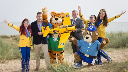 Haven Seashore general manager Nathan Race and airshow director Asa Morrison with members of the Sea
