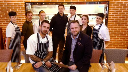 Steve Hutton, who founded Middletons, with staff at the Norwich branch. Photo : Steve Adams