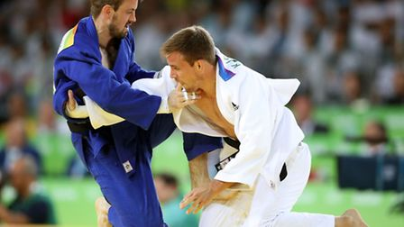Great Britain's Colin Oates (left) during his Men's 66kg bout against France's Killian le Blouch at