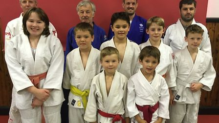 Olympic judoka Colin Oates, centre right, with his father Howard, centre left, at Lopham Village Hal