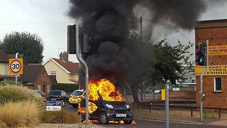 Firefighters at the scene of the car fire on Reepham Road. Picture: Spot that Dog! @ooBeeB 2h