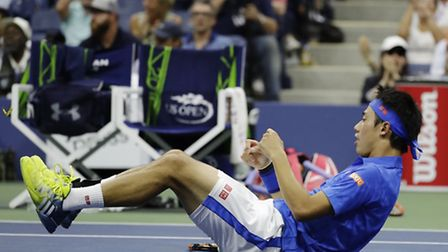 Kei Nishikori, of Japan, reacts after winning a point against Andy Murray, of the United Kingdom, du