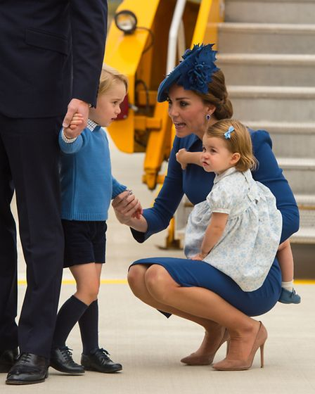 The Duke and Duchess of Cambridge with their children Prince George and Princess Charlotte arrive at