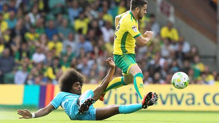 Hamza Choudhury of Burton Albion and Robbie Brady of Norwich in action during the Sky Bet Championsh