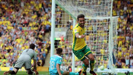 Ivo Pinto of Norwich celebrates scoring his sides 3rd goal during the Sky Bet Championship match at