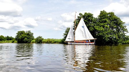 A sailing boat on the River Bure near Horning, Norfolk Broads. Picture: James Bass