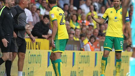 Burton Albion coach Andy Garner loses it on the touchline, leaving Russell Martin somewhat bemused.