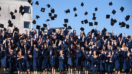 The mortar boards fly at the first day of the UEA graduation ceremonies 2016. Picture: DENISE BRADLE