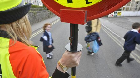 Decisions to scrap road crossing patrols could be put on ice until next year. Pic: Ben Birchall/PA W