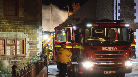 Flames tore through a terrace of homes in Caley Street, Heacham. Picture: Chris Bishop