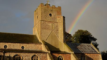 As villagers gathered to remember Tracey Swann at St Mary's Church, at Heacham, a rainbow lit up the