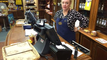 Collett Moore, supervisor of the Mustard Shop, behind the till that a thief stole money from.