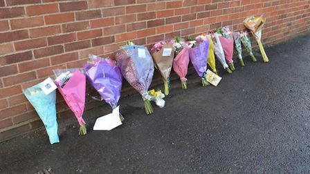 Floral tributes to Tracey Swann at the fire station she campaigned to save in Heacham. Picture: Chri