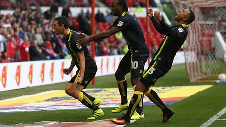 Graham Dorrans celebrates hsi winner for Norwich City at Nottingham Forest with Cameron Jerome and M