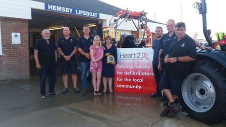 Defibrillator donated to Hemsby lifeboat from Jayne Biggs